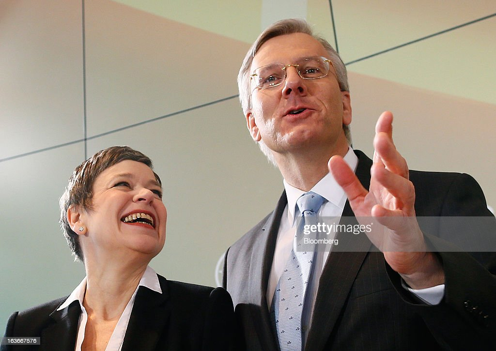 Simone Menne, chief financial officer of Deutsche Lufthansa AG, left, and Chistoph Franz, chief executive officer of Deutsche Lufthansa AG, react while posing for photographs during a news conference to announce company results in Frankfurt, Germany, on Thursday, March 14, 2013. Deutsche Lufthansa AG agreed to renew its short-haul fleet with 100 mostly fuel-efficient jets from Airbus SAS, as the airline seeks to cut kerosene costs that constitute its single biggest expense. Photographer: Ralph Orlowski/Bloomberg via Getty Images