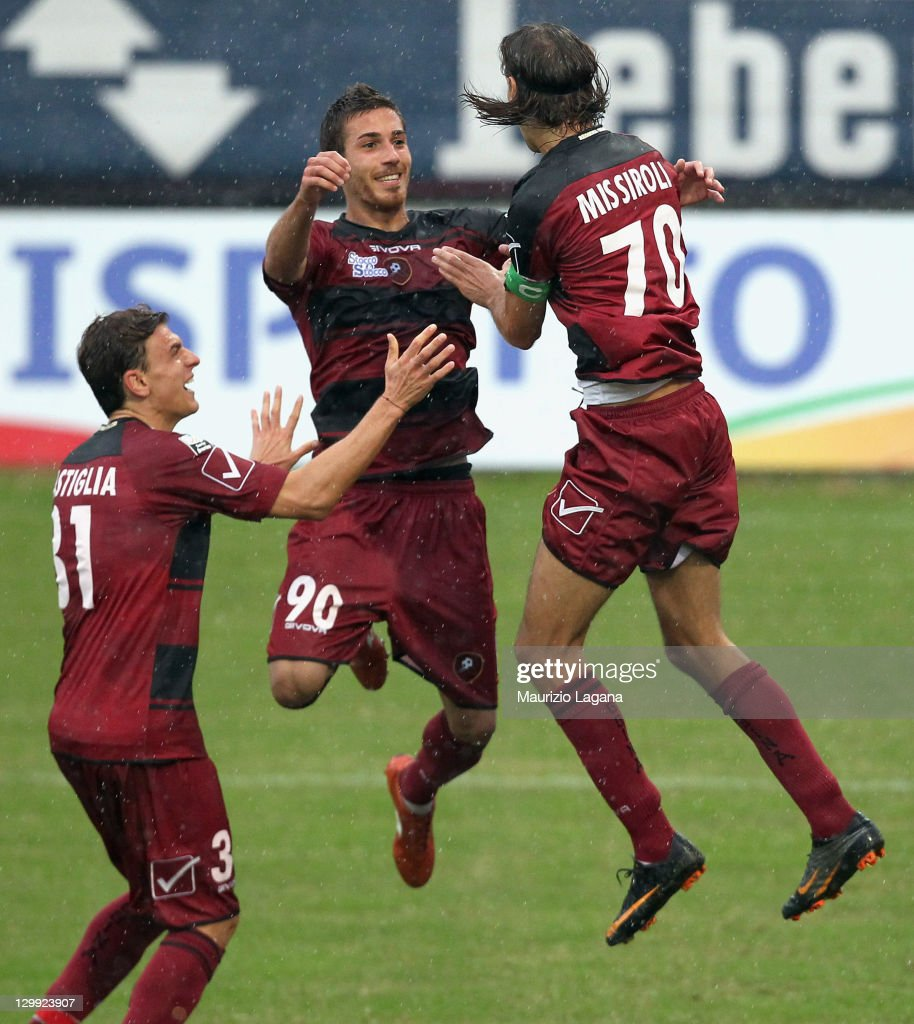 Simone Missiroli of Reggina celebrates with teammates Antonino Ragusa and Ivan Castiglia after scoring their team's second goal from a penalty during...