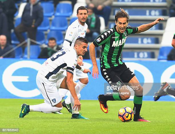 Simone Missiroli of Sassuolo competes for the ball with Rade Krunic of Empoli during the Serie A match between US Sassuolo and Empoli FC at Mapei...