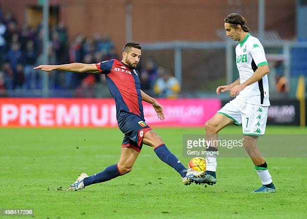 Simone Missiroli of US Sassuolo Calcio battles for the ball with Leonardo Pavoletti of Genoa CFC during the Serie A match between Genoa CFC and US...