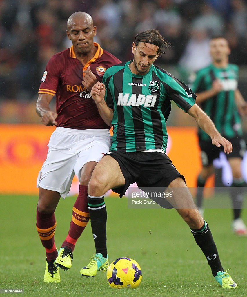 Simone Missiroli of US Sassuolo Calcio competes for the ball with <a gi-track='captionPersonalityLinkClicked' href=/galleries/search?phrase=Maicon+-+Brazil+National+Soccer+Team+and+A.S.+Roma&family=editorial&specificpeople=2639404 ng-click='$event.stopPropagation()'>Maicon</a> (L) of AS Roma during the Serie A match between AS Roma and US Sassuolo Calcio at Stadio Olimpico on November 10, 2013 in Rome, Italy.
