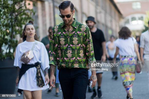Simone Monguzzi wearing a green silk button shirt is seen outside Malibu 1992 during Milan Men's Fashion Week Spring/Summer 2018 on June 19 2017 in...