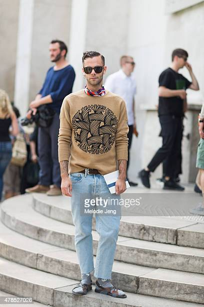 Simone Monguzzi wears an Emilio Pucci scarf Louis Vuitton sweater Levi's jeans and Prada sandals on June 25 2015 in Paris France