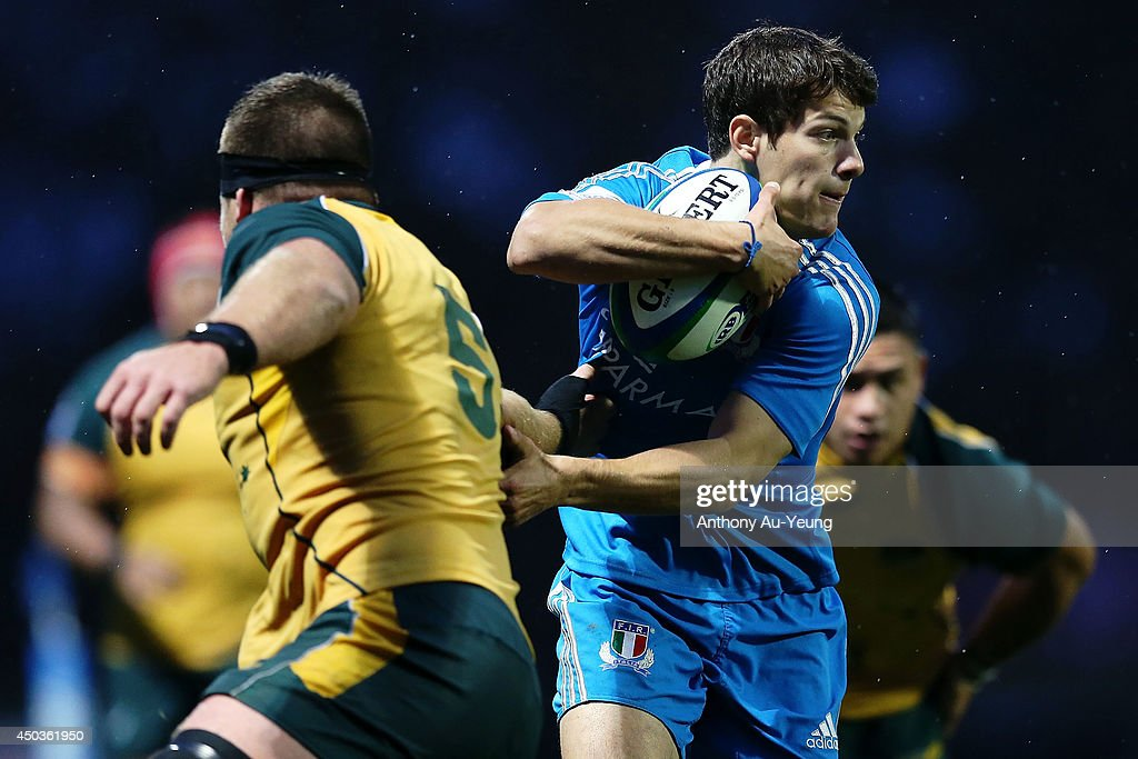 Simone Parisotto of Italy skips the tackle from Jack Payne of Australia during the 2014 Junior World Championship match between Australia and Italy at ECOLight Stadium, Pukekohe on June 10, 2014 in Auckland, New Zealand.
