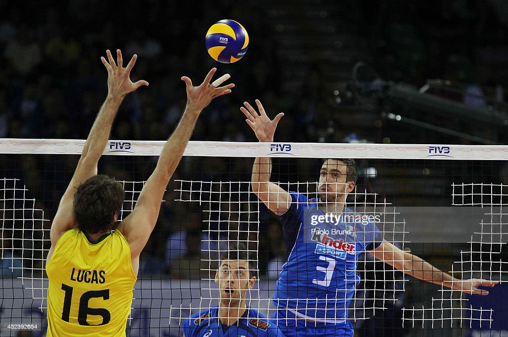 Simone Parodi of Italy spikes the ball as Lucas Saatkamp of Brazil blocks during the FIVB World League Final Six semifinal match between Italy and Brazil at Mandela Forum on July 19, 2014 in Florence, Italy.