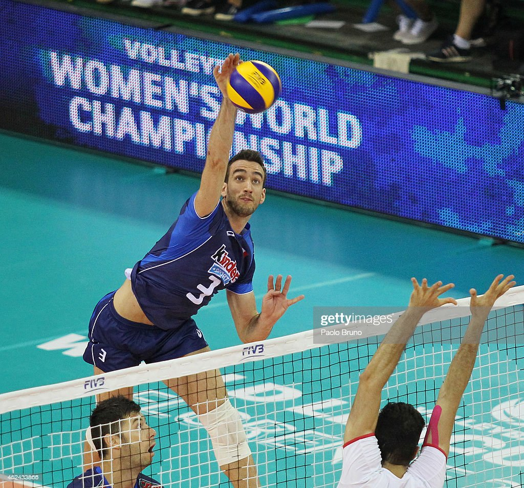 Simone Parodi of Italy spikes the ball during the FIVB World League Final Six match for the third place between Iran and Italy at Mandela Forum on July 20, 2014 in Florence, Italy.