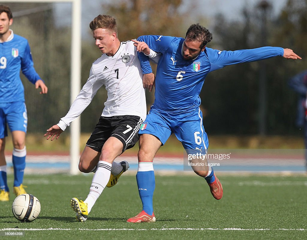 Simone Pasa (R) of Italy competes for the ball with Yannick Gerhardt of Germany during Under 19 International Friendly match between Italy and Germany at Stadio Comunale San Pio on February 6, 2013 in Santo Spirito near Bari, Italy.