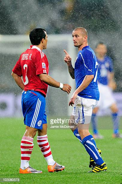 Simone Pepe of Italy has words with Claudio Morel of Paraguay during the 2010 FIFA World Cup South Africa Group F match between Italy and Paraguay at...