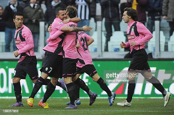 Simone Pepe of Juventus celebrates with teammate Claudio Marchisio after scoring the opening goal of the Serie A match between Juventus FC and Novara...