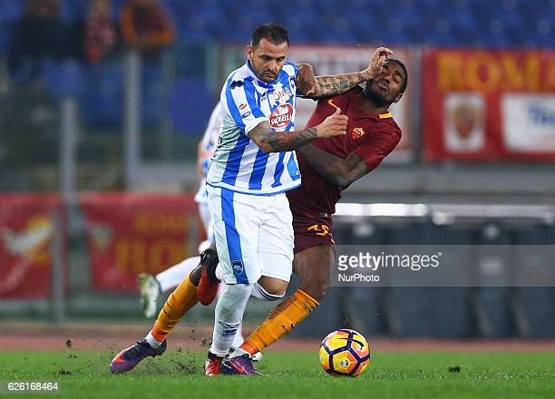 Simone Pepe of Pescara and Gerson of AS Roma during the Serie A match between AS Roma and Pescara Calcio at Stadio Olimpico on November 27 2016 in...
