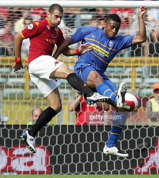 Simone Perrotta of Roma in action against Jorge Andrade of Juventus during the Serie A match between Roma and Juventus at the Stadio Olimpico on...