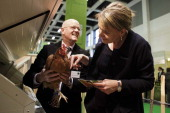 Simone Peter coleader of the German Greens Party touchs a chicken at the Gruene Woche agricultural trade fair on January 17 2014 in Berlin Germany...