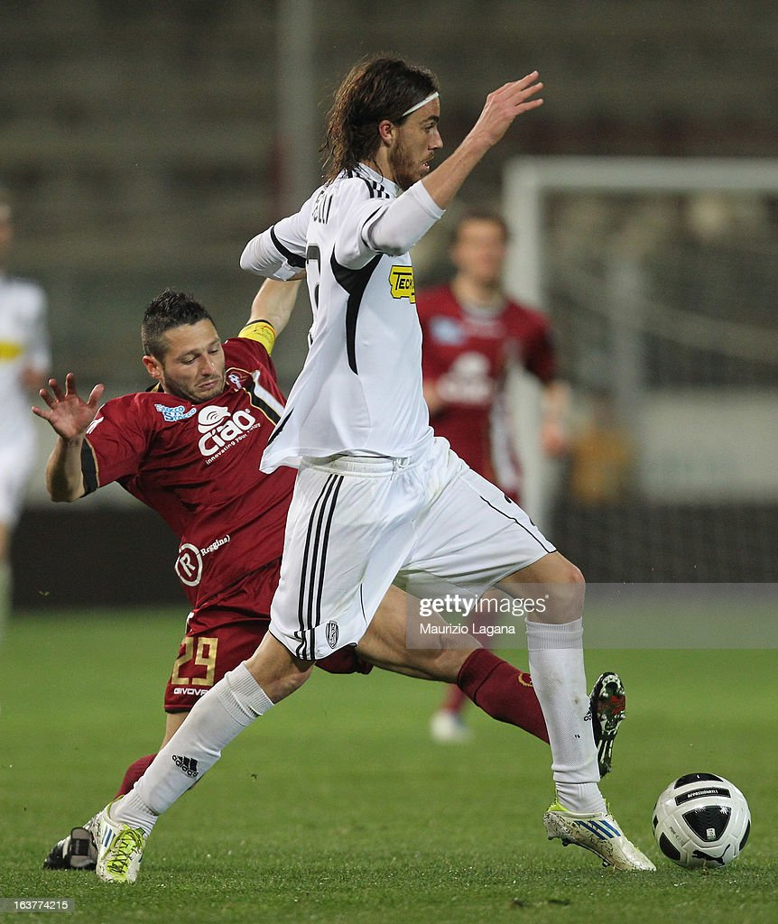 Simone Rizzato (L) of Reggina Calcio competes for the ball with Andrea Tabanelli of AC Cesena during the Serie B match between Reggina Calcio and AC Cesena at Stadio Oreste Granillo on March 15, 2013 in Reggio Calabria, Italy.