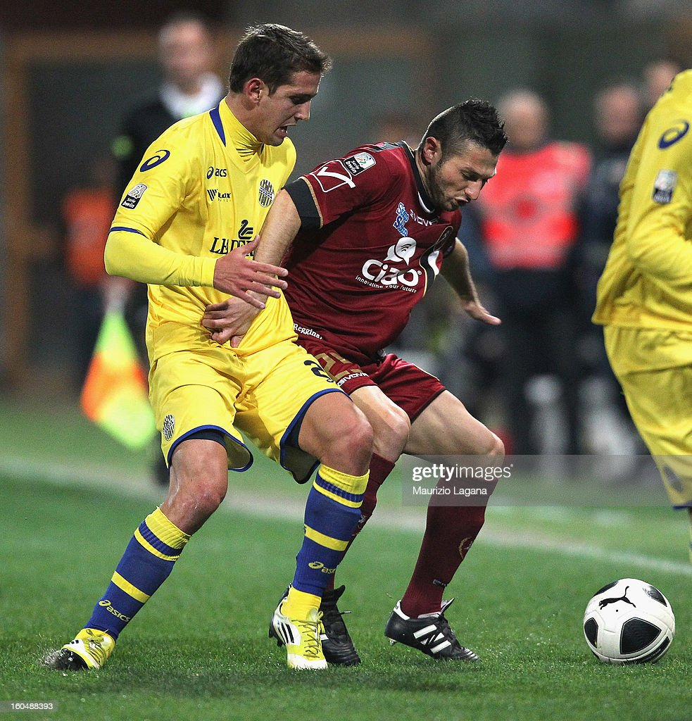 Simone Rizzato (R) of Reggina competes for the ball with Juan Ignacio Gomez of Verona during the Serie B match between Reggina Calcio and Hellas Verona at Stadio Oreste Granillo on February 1, 2013 in Reggio Calabria, Italy.