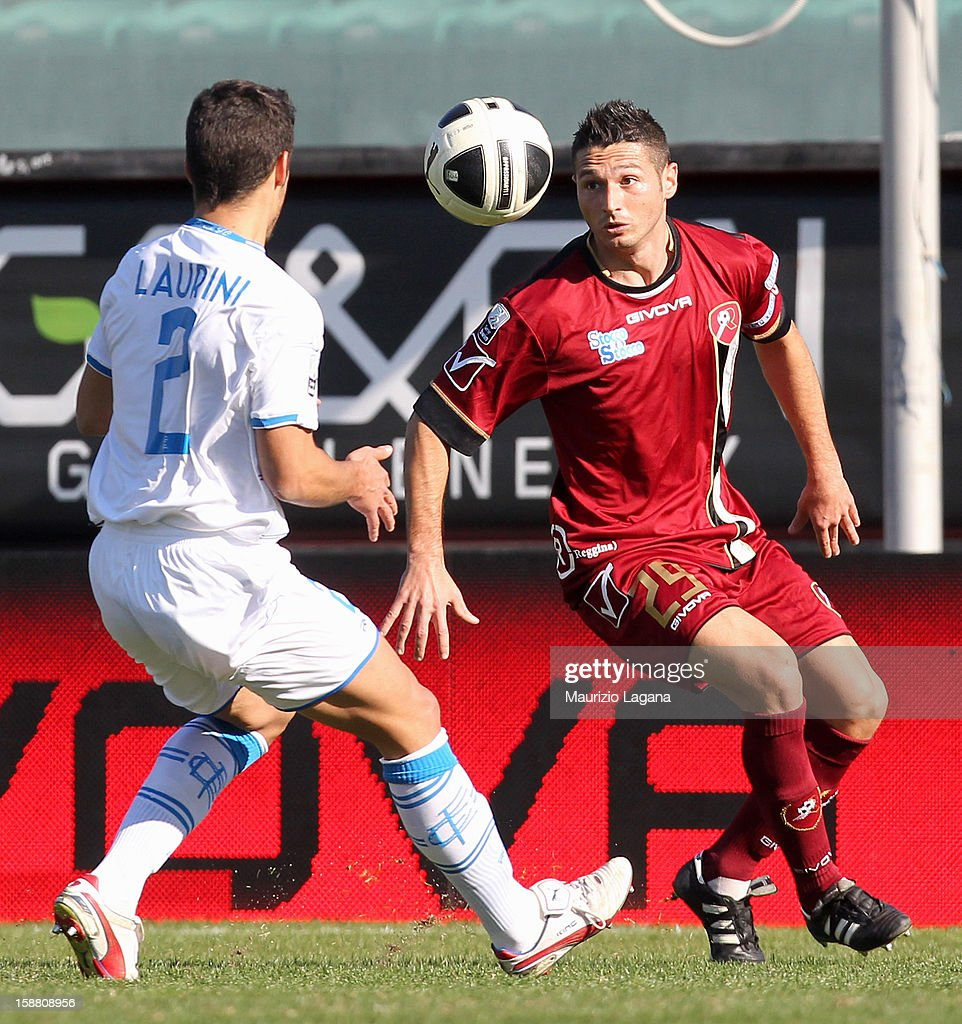 Simone Rizzato (R) of Reggina competes for the ball with Vincent Laurini of Empoli during the Serie A match between Reggina Calcio and Empoli FC at Stadio Oreste Granillo on December 30, 2012 in Reggio Calabria, Italy.