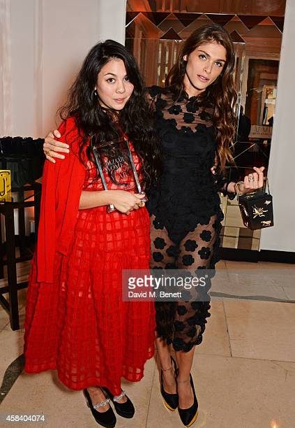 Simone Rocha winner of the Young Designer of the Year award and presenter Elisa Sednaoui pose at the Harper's Bazaar Women Of The Year awards 2014 at...