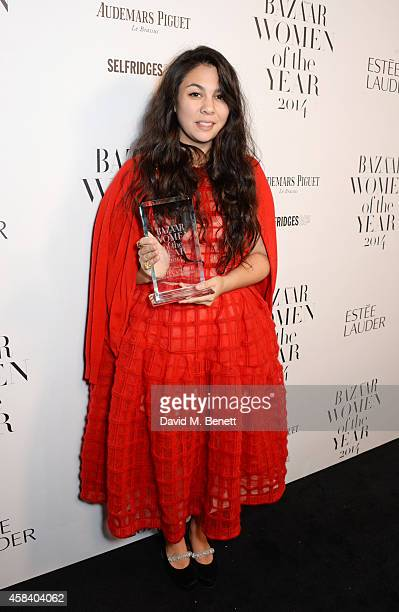 Simone Rocha winner of the Young Designer of the Year award poses at the Harper's Bazaar Women Of The Year awards 2014 at Claridge's Hotel on...