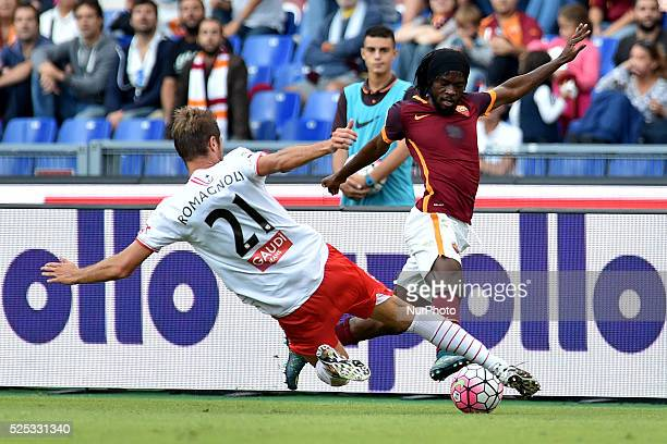 Simone Romagnoli challenges Gervinho during the Italian Serie A match between AS Roma and FC Carpi at Stadio Olimpico in Rome on September 26 2015