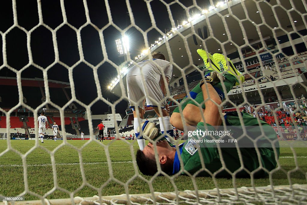 Simone Scuffet of Italy looks dejected after conceeding the second goal during the FIFA U-17 World Cup UAE 2013 Round of 16 match between Italy and Mexico at the Mohamed Bin Zayed Stadium on October 28, 2013 in Abu Dhabi, United Arab Emirates.