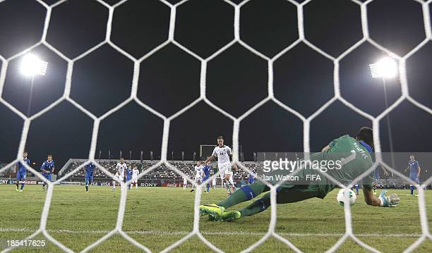 Simone Scuffet of Italy saves a penalty during the Group B FIFA U17 World Cup between Italy and New Zealand at match Ras Al Khaimah Stadium on...