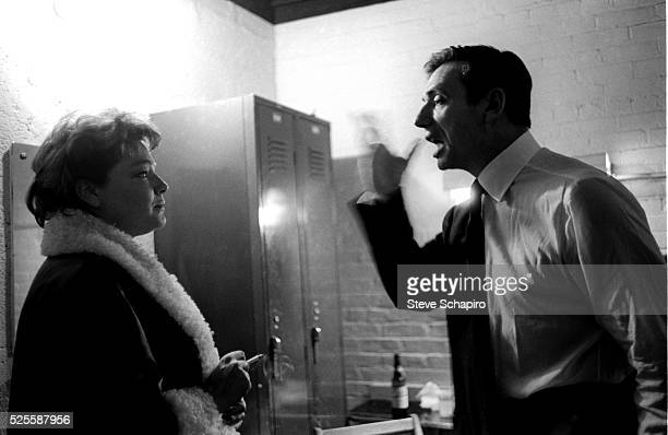 Simone Signoret and husband Yves Montand backstage during the run of An Evening With Yves Montand at the John Golden Theatre