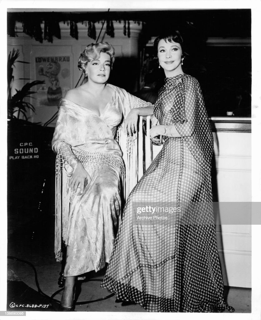 Simone Signoret and Vivien Leigh pose together in a scene from the film 'Ship Of Fools', 1965.