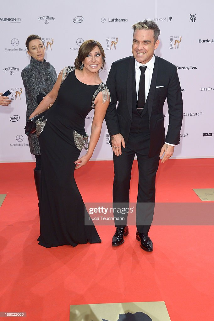 Simone Thomall and <a gi-track='captionPersonalityLinkClicked' href=/galleries/search?phrase=Robbie+Williams&family=editorial&specificpeople=201201 ng-click='$event.stopPropagation()'>Robbie Williams</a> attend the Bambi Awards 2013 at Stage Theater on November 14, 2013 in Berlin, Germany.
