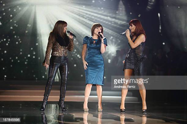 Simone Thomalla Birgit Schrowange and Andrea Berg perform on stage during the Andrea Berg 'Die 20 Jahre Show' at Baden Arena on December 6 2012 in...