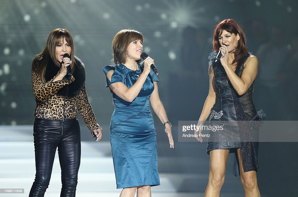 Simone Thomalla, Birgit Schrowange and Andrea Berg perform on stage during the Andrea Berg 'Die 20 Jahre Show' at Baden Arena on December 7, 2012 in Offenburg, Germany.
