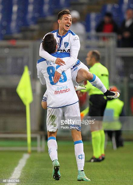 Simone Verdi celebrates with his teammate Matias Vecino of Empoli FC after scoring their first goal during the TIM Cup match between AS Roma and...