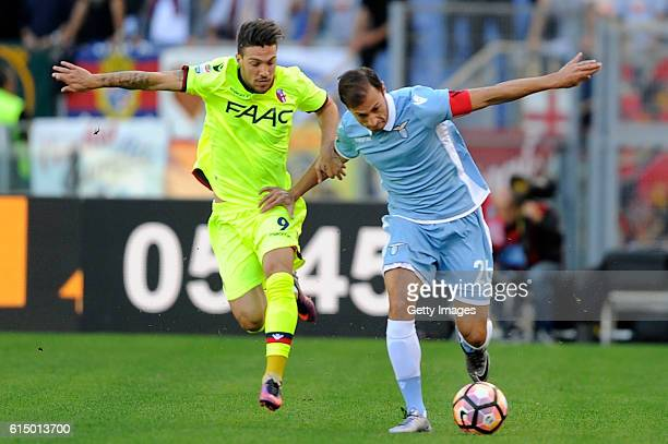 Simone Verdi FC Bologna vies for possession with Stefan Radu SS Lazio during the Serie A match between SS Lazio and Bologna FC at Stadio Olimpico on...