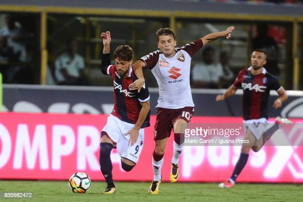 Simone Verdi of Bologna FC competes the ball with Adem Ljajic of Torino FC during the Serie A match between Bologna FC and Torino FC at Stadio Renato...