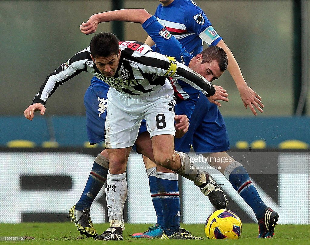 Simone Vergassola (L) of AC Siena fights for the ball with Nenad Krsticic of UC Sampdoria during the Serie A match between AC Siena and UC Sampdoria at Stadio Artemio Franchi on January 20, 2013 in Siena, Italy.