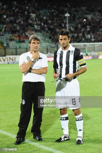 Simone Vergassola of AC Siena gives a player's oath as Mario Beretta head coach of AC Siena looks on during a opening ceremony of Serie B...