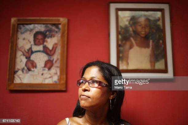 Simone Vieira da Rocha de Lucena poses in front of photos of her children on April 21 2015 in São Gonçalo Brazil