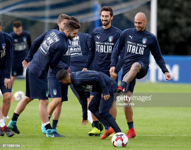 Simone Zaza and Lorenzo Insigne of Italy jokes during the training session at Italy club's training ground at Coverciano on November 9 2017 in...