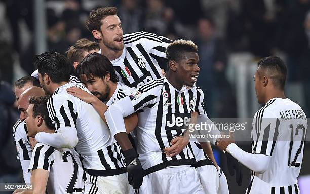Simone Zaza of FC Juventus celebrates after scoring the opening goal with team mates during the TIM Cup match between FC Juventus and Torino FC at...