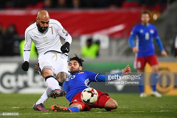 Simone Zaza of Italy is challenged by Michele Polverino of Liechtenstein during the FIFA 2018 World Cup Qualifier between Liechtenstein and Italy at...