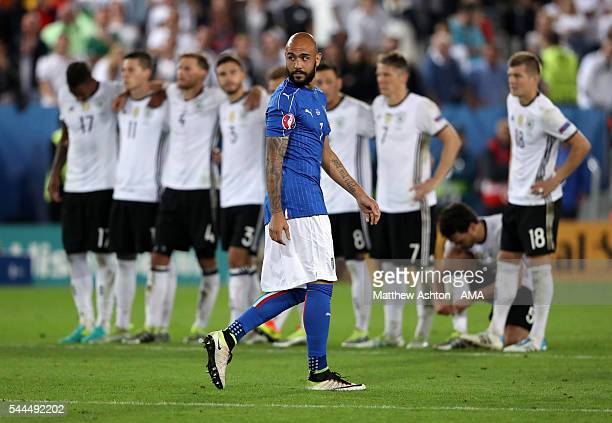 Simone Zaza of Italy reacts after missing a penalty during the penalty shootout during the UEFA Euro 2016 quarter final match between Germany and...