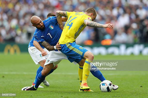 Simone Zaza of Italy tackles Victor Lindelof of Sweden during the UEFA EURO 2016 Group E match between Italy and Sweden at Stadium Municipal on June...