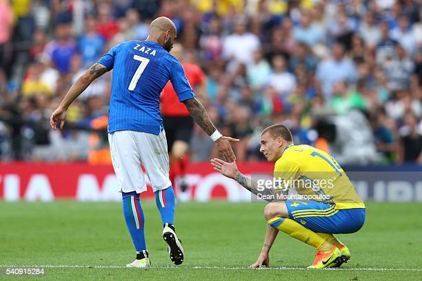 Simone Zaza of Italy touches hands with Victor Lindelof of Sweden during the UEFA EURO 2016 Group E match between Italy and Sweden at Stadium...