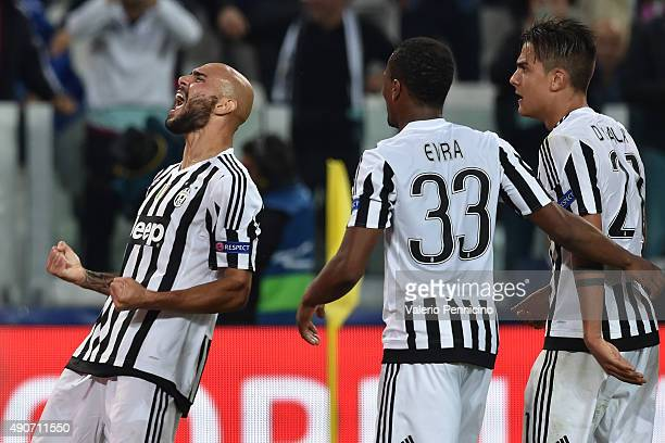 Simone Zaza of Juventus celebrates a goal during the UEFA Champions League group E match between Juventus and Sevilla FC on September 30 2015 in...
