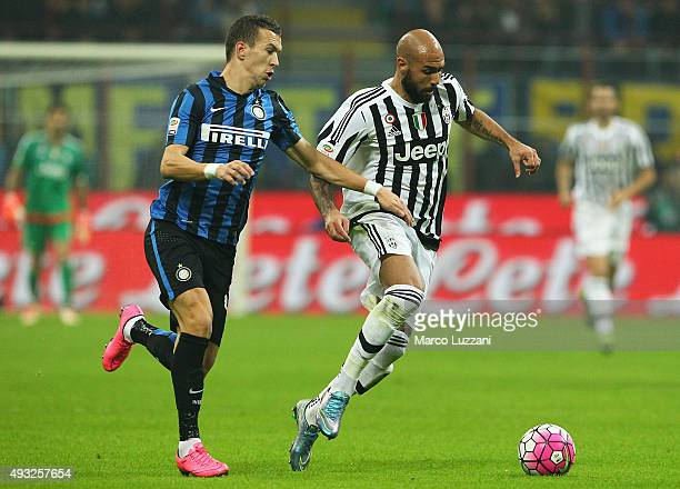 Simone Zaza of Juventus FC competes for the ball with Ivan Perisic FC Internazionale Milano during the Serie A match between FC Internazionale Milano...