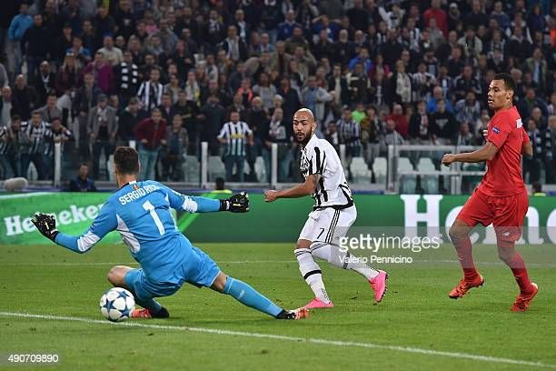Simone Zaza of Juventus scores a goal during the UEFA Champions League group E match between Juventus and Sevilla FC on September 30 2015 in Turin...