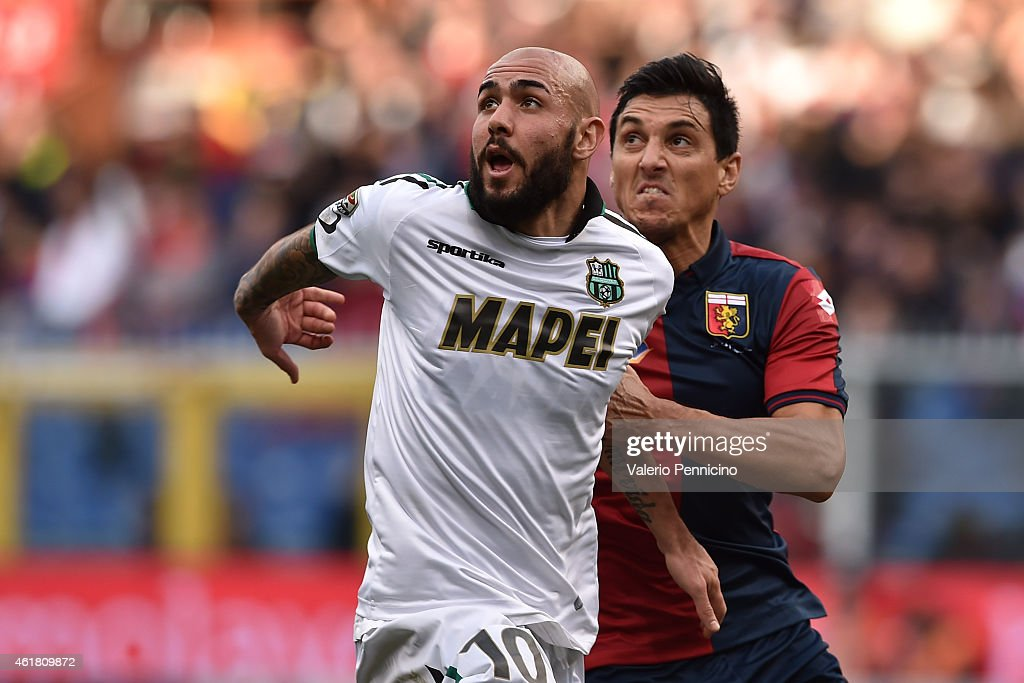 Simone Zaza of US Sassuolo Calcio is challenged by Nicolas Burdisso of Genoa CFC during the Serie A match between Genoa CFC and US Sassuolo Calcio at...