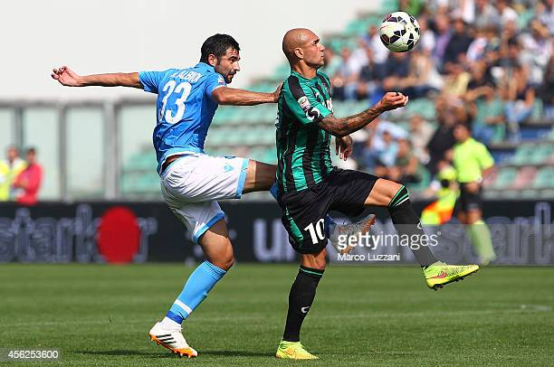 Simone Zaza of US Sassuolo Calcio is challenged by Raul Albiol of SSC Napoli during the Serie A match between US Sassuolo Calcio and SSC Napoli on...