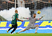 Simone Zaza of US Sassuolo Calcio scores the second team's goal as AS Roma goalkeeper Morgan De Sanctis tries to save during the Serie A match...
