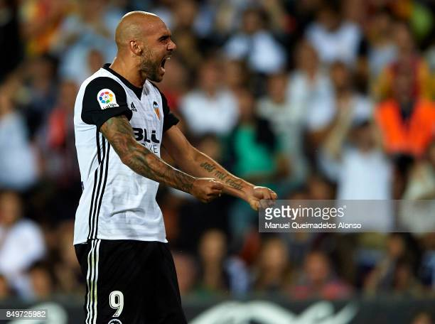 Simone Zaza of Valencia celebrates scoring his team's fourth goal during the La Liga match between Valencia and Malaga at Estadio Mestalla on...