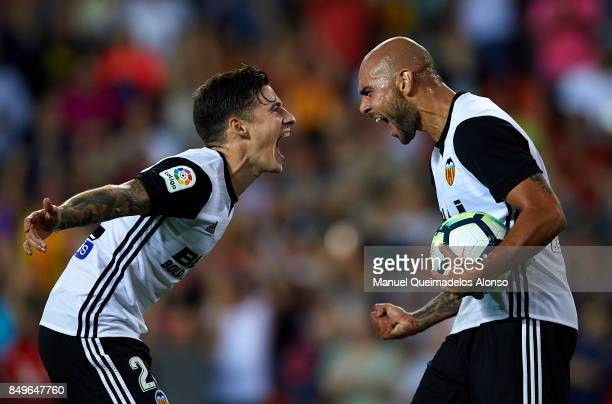 Simone Zaza of Valencia celebrates scoring his team's fourth goal with his teammate Santi Mina during the La Liga match between Valencia and Malaga...