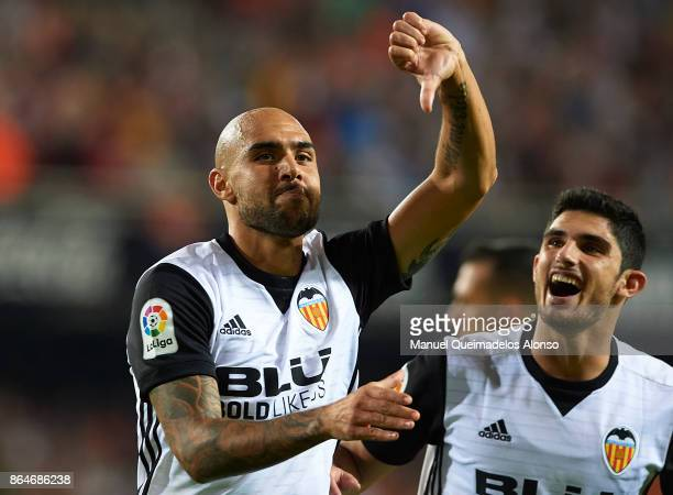 Simone Zaza of Valencia celebrates scoring his team's second goal with his teammate Goncalo Guedes during the La Liga match between Valencia and...